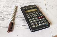 Real estate concept with mortgage loan and tax  statement and calculator - stock photo