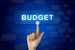 hand press on budget button on touch screen - stock photo