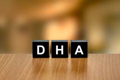 DHA or Docosahexaenoic acid on black block Stock Photos