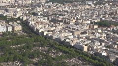 Above Paris in summer sunny day, lot of natural lighting, French cityscape Stock Footage