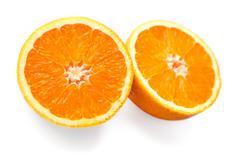 Two halves of oranges on white background - stock photo