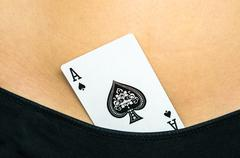 Female sexy body with spades ace card in their panties Stock Photos