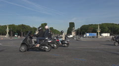 Cars and motorcycles drive in Paris, the Arch of Triumph background, summer day - stock footage
