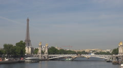 Great bridge Pont Alexander III, Seine river flowing, Eiffel tower by day light Stock Footage