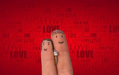 Enamored two fingers with engagement ring - stock photo