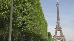 Stock Video Footage of Eiffel tower, Paris champ de mars, green trees and blue sky, perfect parisian