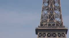 Stock Video Footage of Zoom out to whole Eiffel tower icon french landmark, champ de mars and tourists