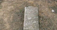 Old muslim cemetery tombstones on ground Stock Footage