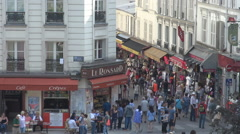 Aerial view of crowded street in Paris, people and tourist visit local shops Stock Footage
