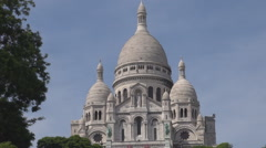 Beautiful Sacre Coeur cathedral in Paris, summer sunny day, tourism, temple Stock Footage