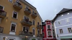 4k Colorful buildings tilt Hallstatt central place Austria Stock Footage