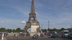 Car traffic around Eiffel tower, bridge Pont d'Iena with french vehicles moving - stock footage