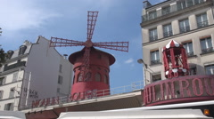 Moulin rouge red mill spinning, famous entertainment in France, Paris landmark Stock Footage