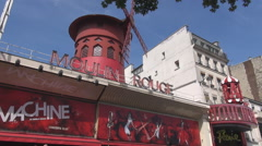 Stock Video Footage of Car's roof top seen near Moulin Rouge in Paris, french world known landmark view