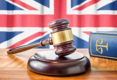 A gavel and a law book - United Kingdom - stock photo