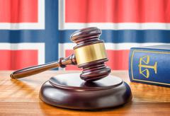 A gavel and a law book - Norway - stock photo
