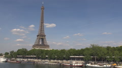 Eiffel Tower great landmark monument in summer sunny day, white cloudscape, boat - stock footage
