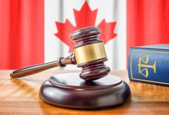 Stock Photo of A gavel and a law book - Canada