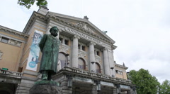 National Theater Oslo Norway staute of Henrik Ibsen in front of building - stock footage