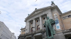 National Theater Oslo Norway staute of Bjørnson in front of building Stock Footage