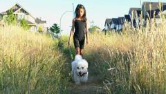 Cute Asian Girl Walking Her Dog In The Summer Stock Footage