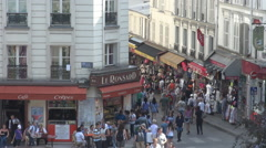 Paris crowd of tourists buy souvenirs from France parisian people passing street Stock Footage