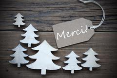 Label And Christmas Trees Merci Means Thank You Stock Photos