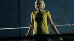 Close up of a slim sportswear girl jumping with skipping rope on the ring Stock Footage