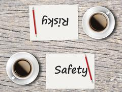 Business Concept : Comparison between safety and risky - stock photo