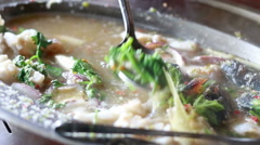 HD footage close up of spicy seafood soup in hot pot Stock Footage