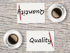 Business Concept : Comparison between quality and quantity - stock photo