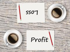 Business Concept : Comparison between profit and loss Stock Photos