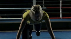 Close-up of a slim woman pushed from the floor in the ring - stock footage