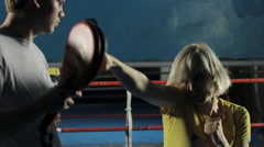 Woman on training of boxing with a personal trainer Stock Footage