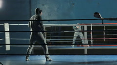 Thai boxer hits punching bag with foot on training Stock Footage