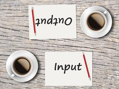 Business Concept : Comparison between input and output - stock photo