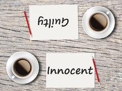 Business Concept : Comparison between guilty and innocent - stock photo