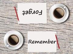 Business Concept : Comparison between forget and remember - stock photo