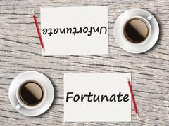 Business Concept : Comparison between fortunate and unfortunate Stock Photos