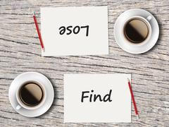 Business Concept : Comparison between find and lose - stock photo