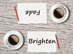 Business Concept : Comparison between fade and brighten - stock photo