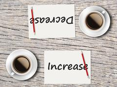 Business Concept : Comparison between decrease and increase Stock Photos