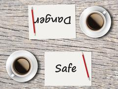 Stock Photo of Business Concept : Comparison between danger and safe
