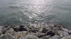 Breakwater Shoreline Close Up On Sunny Day - stock footage