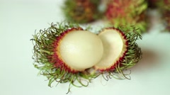 ASIAN RAMBUTAN FRUIT: Camera pulls back from CU main Rambutan fruit Stock Footage