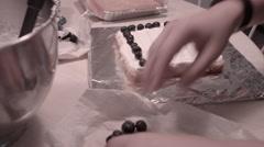 Cake decoration, blueberries on vanilla icing Stock Footage