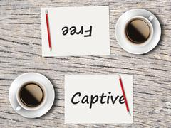 Business Concept : Comparison between captive and free Stock Photos