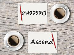 Business Concept : Comparison between ascend and descend Stock Photos