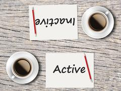 Business Concept : Comparison between active and inactive - stock photo