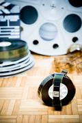 Cinema movie filmstrip with picture start frame and other movie objects - stock photo